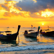 Traditional thai boats at sunset beach — Stock Photo #39766489