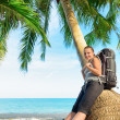 Stock Photo: Young female backpacker on beach
