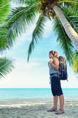 Young female backpacker on a beach — Stock Photo