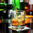 Whiskey pouring a glass in a bar — ストック写真