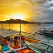 Traditional boats at sunset. Philippines — Stock Photo #40496403