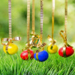 Easter eggs hanging on golden ribbons — Stock Photo #41220343