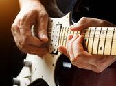 Man playing guitar. Close-up view — Stock Photo