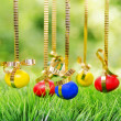 Easter eggs hanging on golden ribbons — Stock Photo #42821467