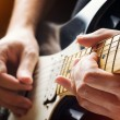 Man playing guitar. Close-up view — Stock Photo #43015355