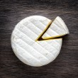 Camembert cheese on a wooden board — Stock Photo #43699977