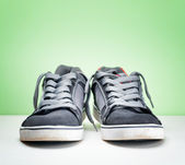 Pair of grey sneakers on colorful background — Stock Photo