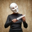 Woman in white mask holding the knife — Stock Photo #44117725