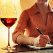 Wine tasting. Sommelier making notes in notebook — Stock Photo #44117913