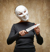 Woman in white mask holding the knife — Stock Photo