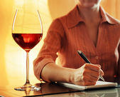 Wine tasting. Sommelier making notes in notebook — Stock Photo