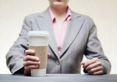 Business woman with a tumbler of coffee — Stock Photo