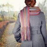 Young woman walking in the fall season — Stock Photo #48454245
