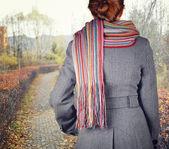 Young woman walking in the fall season — Stock Photo