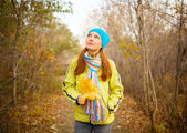 Young woman walking in the fall season. Autumn outdoor portrait — Stok fotoğraf