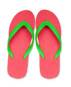 Red ang green flip flop sandals isolated — Stock Photo