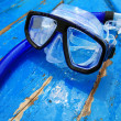 Snorkel on blue wood — Stock Photo