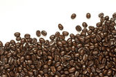 Many coffee beans on white background — Stock Photo