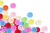 Multi color buttons on white background with copy space — Stock Photo