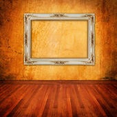 Old grunge wall with vintage frame — Stock Photo