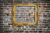 Golden Frame on Old Brick Wall Background — Stock Photo