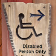 A handicapped sign on wood wall — Stock Photo #50705621