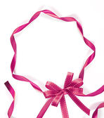 Pink ribbon on white background with copy space — Stock Photo