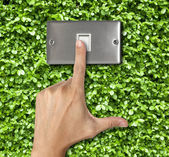 Human finger turn off switch on Plant Background — Stock Photo