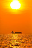 Silhouette of cargo ship — Stock Photo