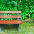 Bench in the garden - Stock Photo