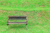Bench with grass background — Stock Photo