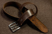 Brown leather belt — Zdjęcie stockowe