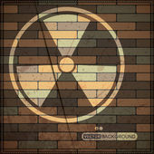 Background with radiation symbol on brick wall — Stok Vektör