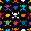 Colored skulls and hearts on black background - seamless pattern — Stock Vector