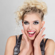 Beautiful happy blonde young woman — Stock Photo #12585669