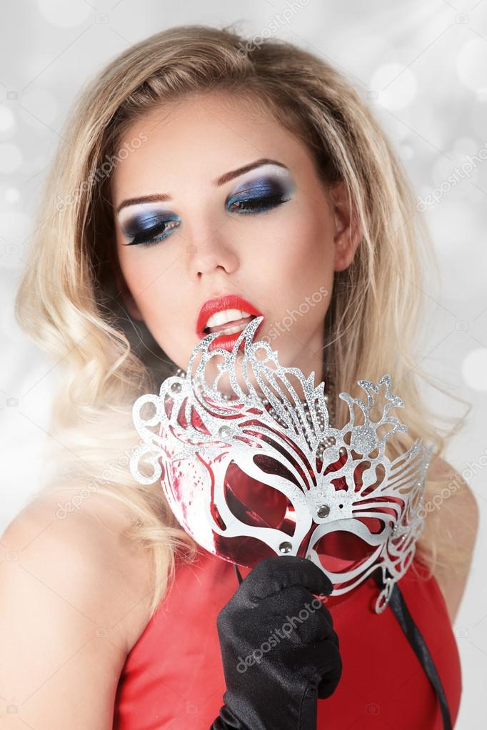 Beautiful blonde young woman with carnival mask studio portrait — Stock Photo #12739630