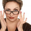 Woman looking over glasses — Stock Photo