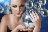 Woman with disco ball — Stock Photo
