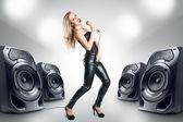 Karaoke singer at night club — Stock Photo