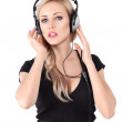 Young blonde woman with headphones — Stock Photo #22827310