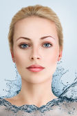 Young woman in water dress — Stock Photo