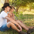 Young woman and man with retro bicycle in a park - Stock Photo