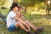 Young woman and man with retro bicycle in a park — Stock Photo