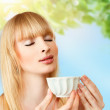 Stock Photo: Woman with herbal tea