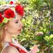 Young woman in a garden — Stock Photo #25052355