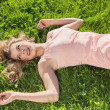 Young woman lying on grass — Stock Photo #25089225