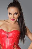 Beautiful woman in red corset — Stock Photo