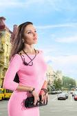 Elegant woman at city street — Stock Photo