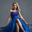 Young woman in luxurious blue dress — Stock Photo #27174365