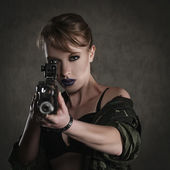 Beautiful young woman with a rifle — Stock Photo